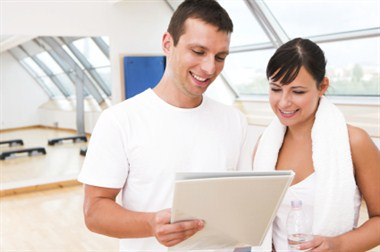 Photo of Man and Woman reviewing club orientation documents