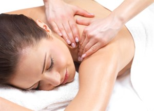 Woman receiving massage therapy services