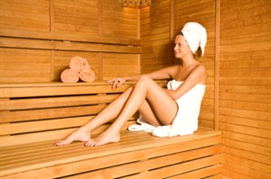 Woman seated in sauna
